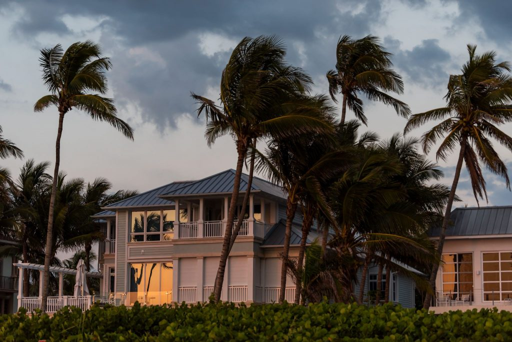 Coast house beachfront waterfront vacation home, house during evening sunset