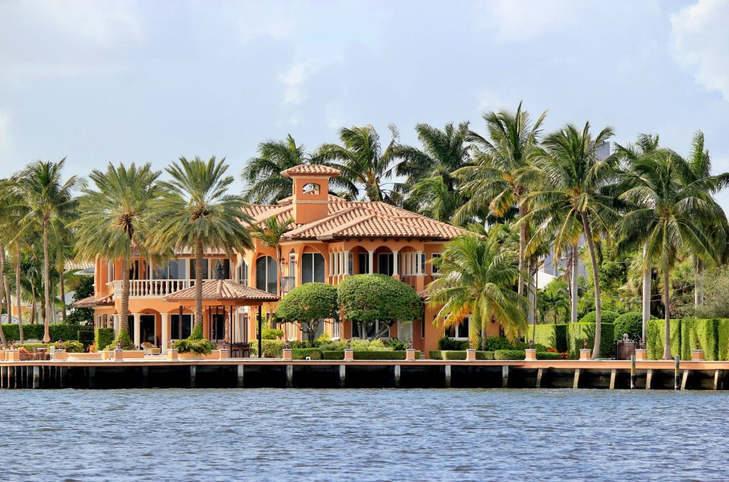 Oceanfront home with coconut palm trees